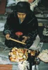 Woman praying for her ancestors