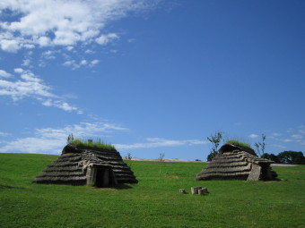 Restored pit dwellings at the Kitakogane Shell Midden