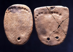 Clay tablets with footprints excavated at the Kakinoshima Site in Hakodate