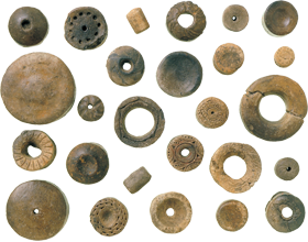 Clay earrings excavated at the Moheji Site in Hokuto